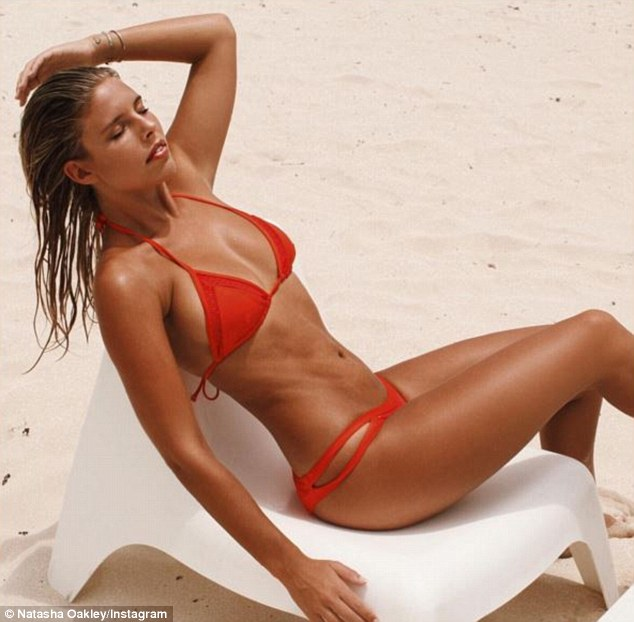 Life's a beach: She often whisks away in First Class to the far corners of the globe to post for her blog, A Bikini A Day