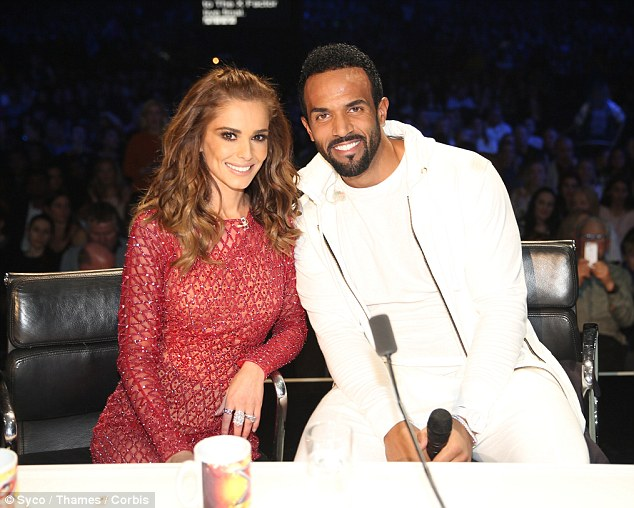 Could he help her act win the show? Craig David and Cheryl Fernandez-Versini pose up a storm