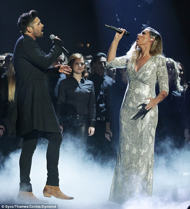 Duo: Olly Murs then introduced Ben Haenow and Leona Lewis for a duet which saw them do a new song from his LP, plus her version of Cars
