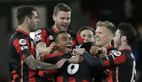 Junior Stanislas (centre) is mobbed by his team-mates after the hosts took a surprise lead in bizarre fashion
