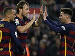 Barcelona's Ivan Rakitic, left, celebrates scoring his side's second goal with teammate Lionel Messi, right, during a Spanish La Liga soccer match between FC Barcelona and Deportivo Coruna at the Camp Nou stadium in Barcelona, Spain, Saturday, Dec. 12, 2015. (AP Photo/ Emilio Morenatti)