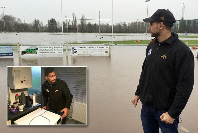 Amir Khan takes time out of his schedule to help flood-affected areas in Carlisle