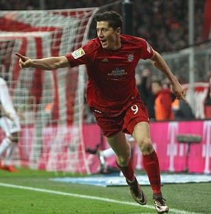 Bayern Munich stars Robert Lewandowski and Philipp Lahm net against Ingolstadt while