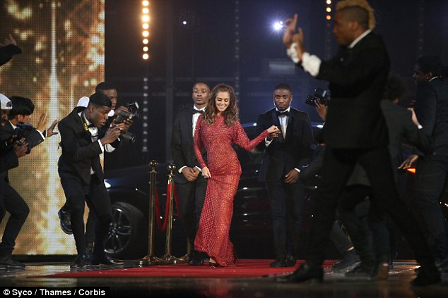 Her very own red carpet: After arriving on stage in a chauffeur-driven car, Cheryl sashayed down her runway