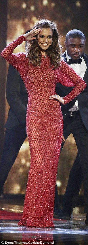 Brave face:There was little sign of what must have been a trying week for the star as she headed to her seat, with the Fight For This Love singer flashing a huge smile and giving her signature salute for the audience