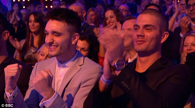 Supportive: Jay performed in front of his former bandmates, Tom Parker (L) and Max George (R)