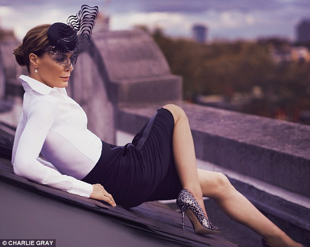 Tara Palmer-Tomkinson wears KUBBI, Desiderata; SKIRT, Elie Tahari, from Harrods; HAT, Philip Treacy; EARRINGS, Carat; SHOES, Lucy Choi London