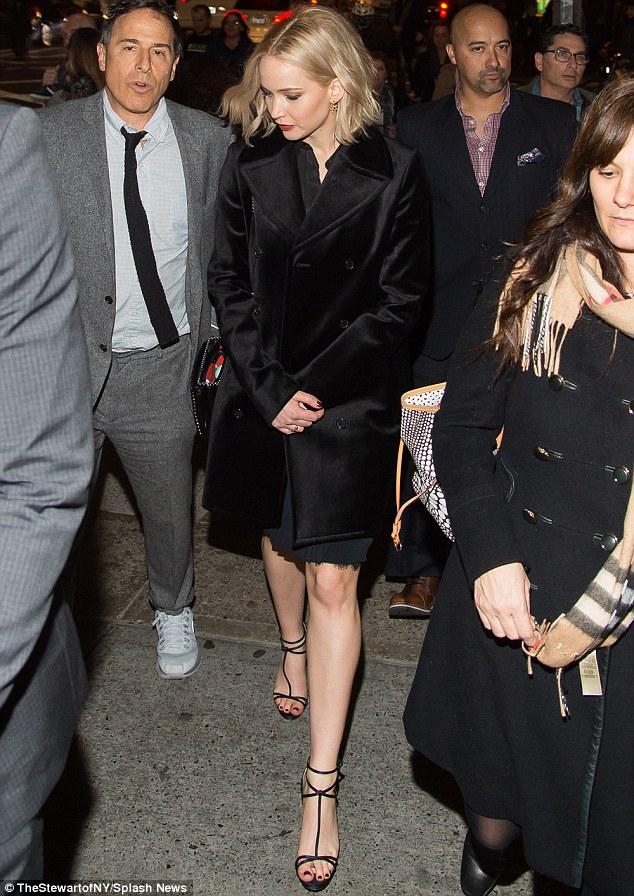 Always chic: Jennifer Lawrence had the opportunity to demonstrate her fashion prowess again when she attended a screening of her new film Joy on Saturday in New York with director David O. Russell (L)