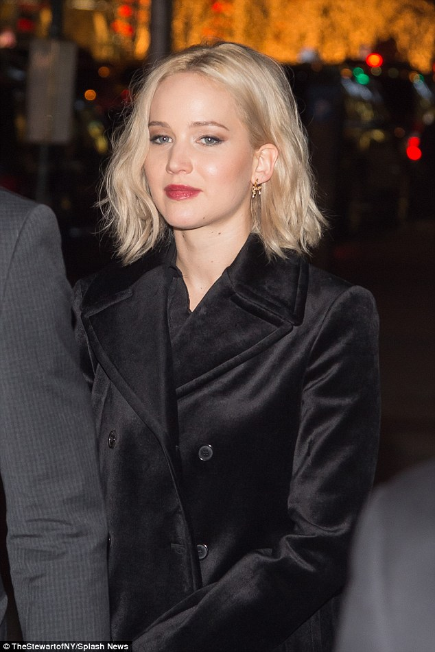 Mostly natural beauty: Some crimson lipstick coordinated well with a similar shade of nailpolish, while her makeup was limited to some rouge and light eyeliner