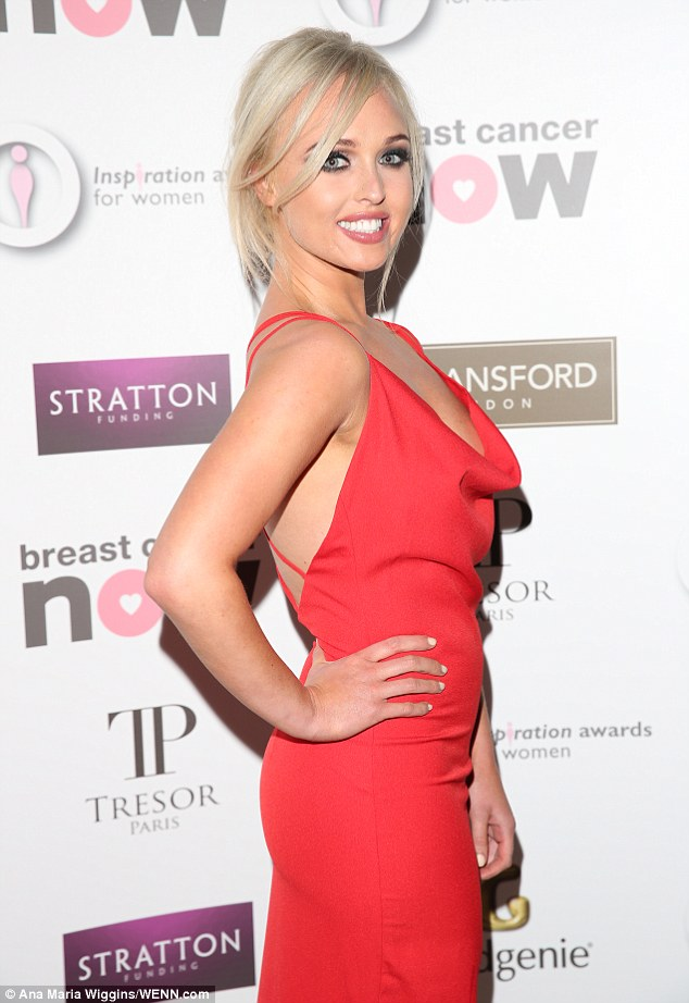 Stunning star:The blonde beauty donned a plunging red dress boasting a stylish cowl-neck, which displayed her cleavage to full effect