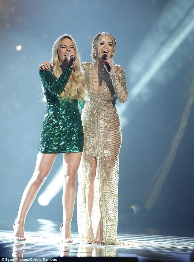 Blonde beauties: Louisa and Rita slipped in sequinned numbers for their on-stage duet