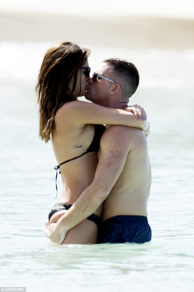 Hands-on: Danielle Lloyd could hardly keep her hands off her new beau Michael O'Neill as they enjoyed a dip in the sea on Saturday as they continue to enjoy their holiday to Barbados