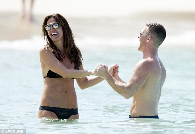 Mucking about: The couple shared a giggle as they played around in the water