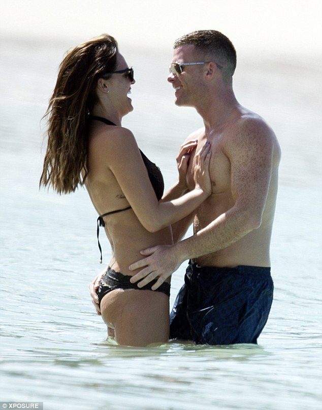 Cheeky: Michael placed his right hand on Danielle's derrière in a cheeky moment in the waters