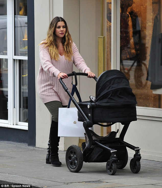 Girls' day out: Imogen Thomaslooked gorgeous in a cosy pink sweater as she pushed her three-week-old daughter Siera in a pram around Kensington on Saturday