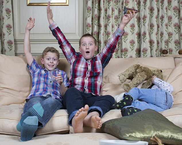 Toby (left) is watching the shows with best friend Sam, ten (centre), and Sam's brother James, five (right)