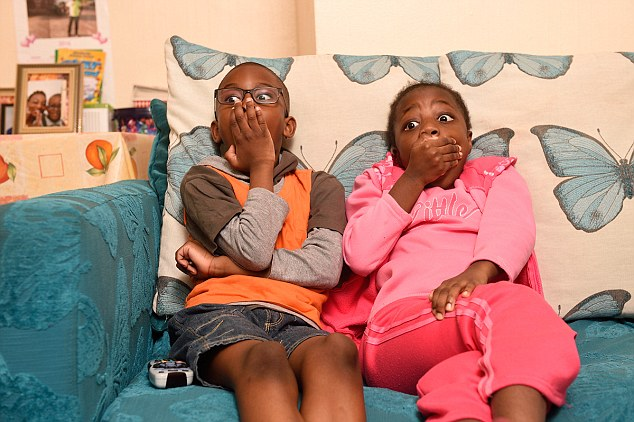 Shuaib, eight, is watching the shows with her friend Janai, seven (left) in East London