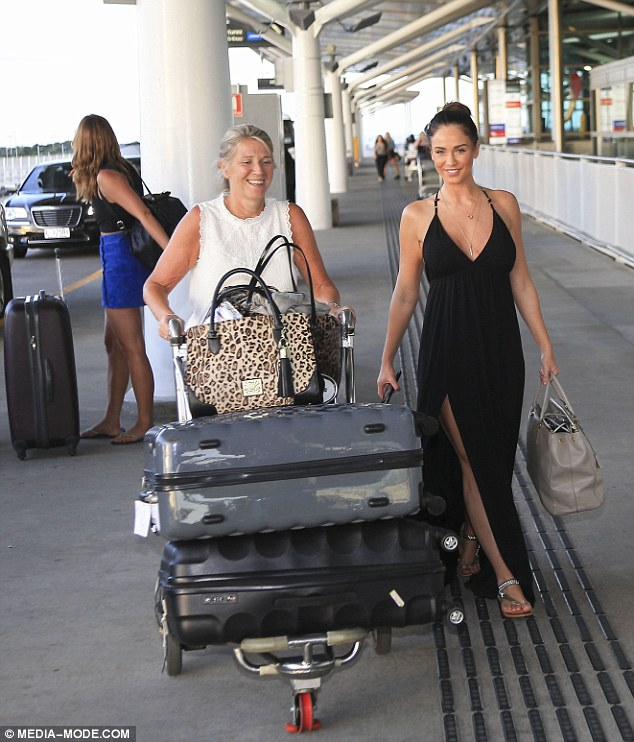 Caroll, pictured here with Vicky at Brisbane Airport as the pair headed back to the UK following the I'm A Celebrity final, says she's thrilled that at last 'Kick-off Vicky' has finally revealed her intelligence