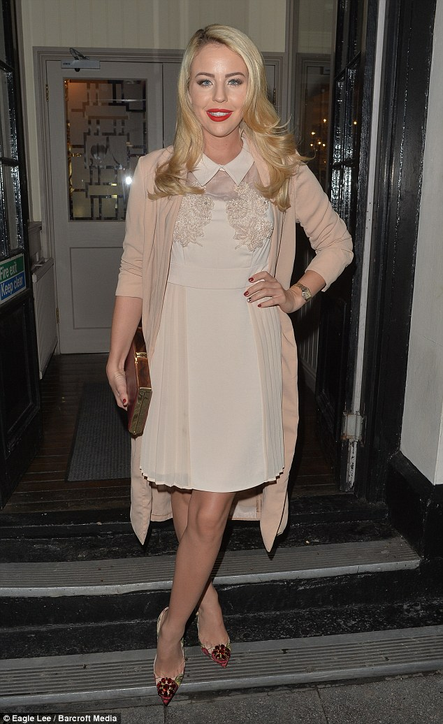 Super chic: TOWIE star Lydia Bright glammed up in a pretty cream dress for a bash at her favourite Essex hotspot The Sugar Hut on Thursday night