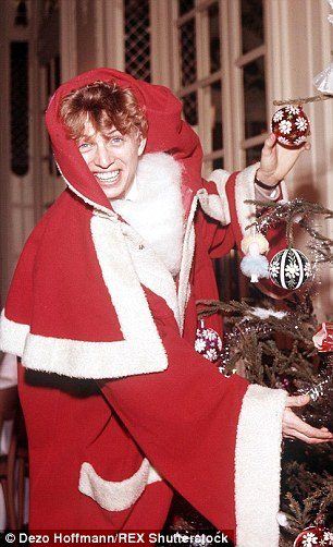 Tommy Steele's version of Must Be Santa, left, was released in 1961 and reached No 40 for just a week