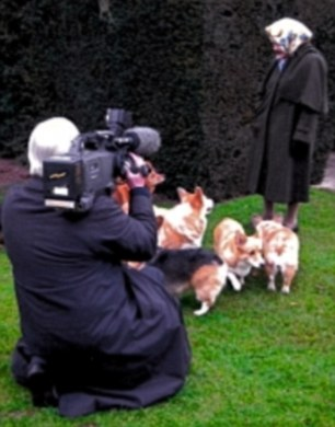 Here he captures the Queen with her beloved corgis