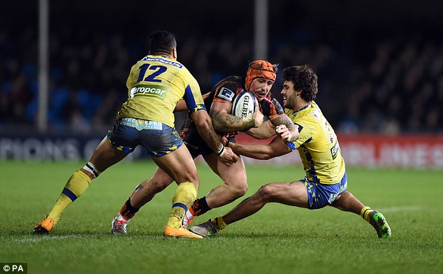 Exeter centre Jack Nowell is tackled by Clermont's Hosea Gear (left) and Pato Fernandez