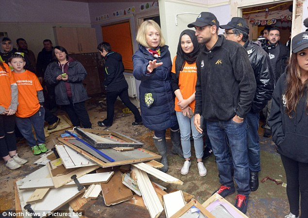 Khan looks upset as he sees with his own eyes just how much damage has been caused by the flooding