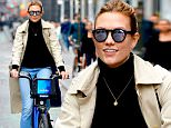 Picture Shows: Karlie Kloss  December 12, 2015\n \n Supermodel Karlie Kloss makes riding a bike look good as she pedals through the city with a smile on her face in New York City, New York.\n \n Non Exclusive\n UK RIGHTS ONLY\n \n Pictures by : FameFlynet UK © 2015\n Tel : +44 (0)20 3551 5049\n Email : info@fameflynet.uk.com