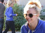 Britney Spears heads to dance class in Calabasas with a big smile on her face and her hair held up in a high ponytail. Saturday, December 12, 2015. X17online