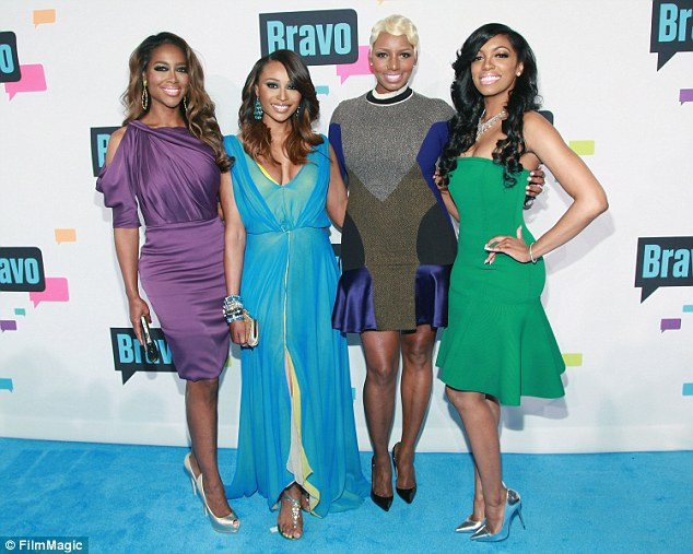 Kenya, left, joined the Bravo reality series in season five, while NeNe, third from left, was one of the original cast members. They're pictured in April 2013 with Cynthia Bailey, second from left, and Porsha Stewart, right