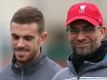 LIVERPOOL, ENGLAND - DECEMBER 09:  Manager Jurgen Klopp (R) and Jordan Henderson look on  during the Liverpool training session at the Melwood training ground on December 9, 2015 in Liverpool, England.  (Photo by Alex Livesey/Getty Images)