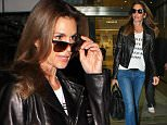 Cindy Crawford wore jeans and a leather jacket for her flight into LAX.  The supermodel had also pulled on a t-shirt repping Violet Gray's Hair So Good It Should Be Insured line.  Friday, December 11, 2015 X17online.com