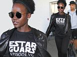 LOS ANGELES, CA - DECEMBER 11: Lupita Nyong'o is seen at LAX on December 11, 2015 in Los Angeles, California.  (Photo by GVK/Bauer-Griffin/GC Images)