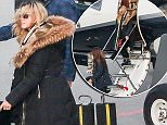 EXCLUSIVE: Madonna with family and entourage arrives at the Zurich airport in Switzerland\n\nRef: SPL1185400  121215   EXCLUSIVE\nPicture by: Splash News\n\nSplash News and Pictures\nLos Angeles: 310-821-2666\nNew York: 212-619-2666\nLondon: 870-934-2666\nphotodesk@splashnews.com\n