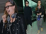 """EXCLUSIVE ***MINIMUM FEE £500 PER PAPER APPLIES*** Cara Delevingne shows off her geeky side, as she walks through Heathrow Airport with girlfriend  Annie Clark aka St Vincent, wearing some thick black rimmed glasses. She was also wearing a """"Cake"""" necklace, in reference to her close friendship with Kendall Jenner\n11 December 2015.\nPlease byline: Will/PalaceLee/Vantagenews.com"""