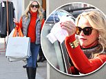 Reese Witherspoon wore a puffy down vest over a red sweater , with jeans, for a quick holiday shopping trip, in Beverly Hills, on Friday, December 11, 2015 X17online.com