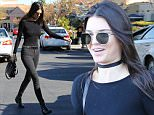 Kendall Jenner hits Barnes And Nobel for some holiday shopping. The supermodel decked out in entirely black and wearing a choker around her neck, can't hold back a huge smile upon leaving with a mystery man. Saturday, December 12, 2015. X17online