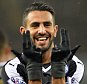 SWANSEA, ENGLAND - DECEMBER 05: GOAL Riyad Mahrez of Leicester City celebrates after completing his hat trick to make it 0-3 during the Premier League match between Swansea City and Leicester City at the Liberty Stadium on December 05, 2015 in Swansea, United Kingdom.  (Photo by Plumb Images/Leicester City FC via Getty Images)