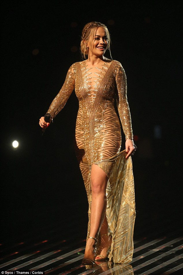 Glimmering girl:The Julien Macdonald gold number was show-stopping as it showed off a generous amount of the star's ample cleavage as well as boasting a raunchy split to give a flash of leg