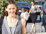 Please contact X17 before any use of these exclusive photos - x17@x17agency.com   EXCLUSIVE - Jennifer Garner is all smiles as she runs errands and carries a tray of holiday cookies with children Violet, Seraphina and Samuel in Brentwood, CA. Jennifer looks lovely in a grey sleevless blouse, pencil skirt and high heels. Sunday, December 13, 2015. X17online.com
