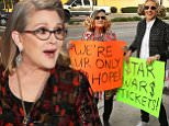 Iconic Star Wars actress CARRIE FISHER  makes a cameo appearance on The Ellen DeGeneres Show on Monday, December 14th and helps giveaway tickets to opening night of Star Wars: The Force Awakens¿ to drivers passing by!