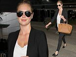 Supermodel, Kate Upton arrives in Los Angeles wearing skinny jeans, a black blazer & a lowcut blouse.  The sexy model/actress was seen at LAX making her way to a waiting limo.   Pictured: Kate Upton Ref: SPL1194514  111215   Picture by: Sharky / Splash News  Splash News and Pictures Los Angeles: 310-821-2666 New York: 212-619-2666 London: 870-934-2666 photodesk@splashnews.com