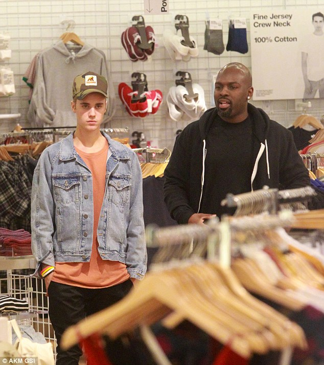 Miss Carter, originally from Leeds, said Bieber (pictured yesterday shopping in Los Angeles with Kris Jenner's boyfriend Corey Gamble) led her to his room where another woman lay on the bed