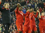 ****caption correction****Liverpool Manager Jurgen Klopp leads the Liverpool players in a salute to the fans in the Kop after the final whistle in the Barclays Premier League Match between Liverpool and West Bromwich Albion played at Anfield, Liverpool on 13th December 2015