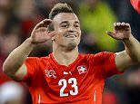 Swiss midfielder Xherdan Shaqiri celebrates with team mates the victory at the end of the Euro 2016 qualifying football match between Switzerland and Slovenia at the St. Jakob park stadium in Basel on September 5, 2015. AFP PHOTO / FABRICE COFFRINI        (Photo credit should read FABRICE COFFRINI/AFP/Getty Images)