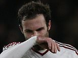 """Manchester United's Spanish midfielder Juan Mata gestures during the English Premier League football match between Bournemouth and Manchester United at the Vitality Stadium in Bournemouth, southern England on December 12, 2015. Bournemouth won the match 2-1.  AFP PHOTO / IKIMAGES RESTRICTED TO EDITORIAL USE. No use with unauthorised audio, video, data, fixture lists, club/league logos or """"live"""" services. Online in-match use limited to 45 images, no video emulation. No use in betting, games or single club/league/player publications.IAN KINGTON/AFP/Getty Images"""
