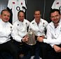 (L-R) England management, Graham Rowntree, Mike Catt, head coach Stuart Lancaster and Andy Farrell pose in the dressing room with The Calcutta Cup after victory in the RBS Six Nations match between Scotland and England at Murrayfield Stadium on February 8, 2014 in Edinburgh, Scotland.  (Photo by David Rogers/Getty Images)