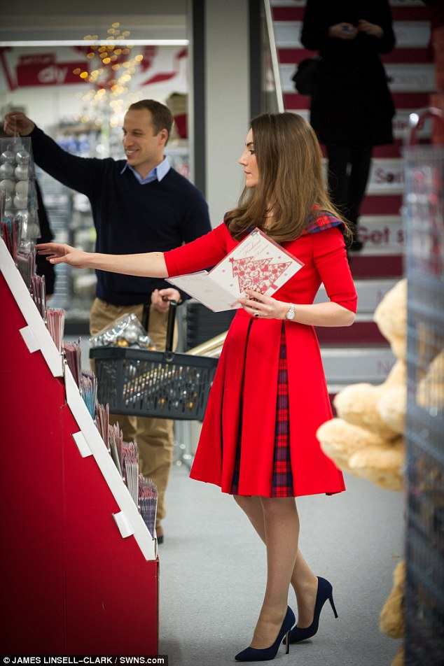 Ms Aga was spotted browsing the card selection in the price-friendly store as Mr Watkinson looked on