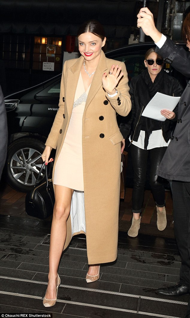 She's here: She arrived at the venue earlier that evening wearing a camel coat and carrying a black leather Givenchy handbag