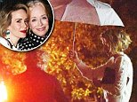 EXCLUSIVE: Sarah Paulson shields her older girlfriend Holland Taylor from the pouring rain with an umbrella as the couple are seen at a friends birthday party in Sherman Oaks in Los Angeles!\n\nPictured: Sarah Paulson, Holland Taylor\nRef: SPL1195390  141215   EXCLUSIVE\nPicture by: Splash News\n\nSplash News and Pictures\nLos Angeles: 310-821-2666\nNew York: 212-619-2666\nLondon: 870-934-2666\nphotodesk@splashnews.com\n